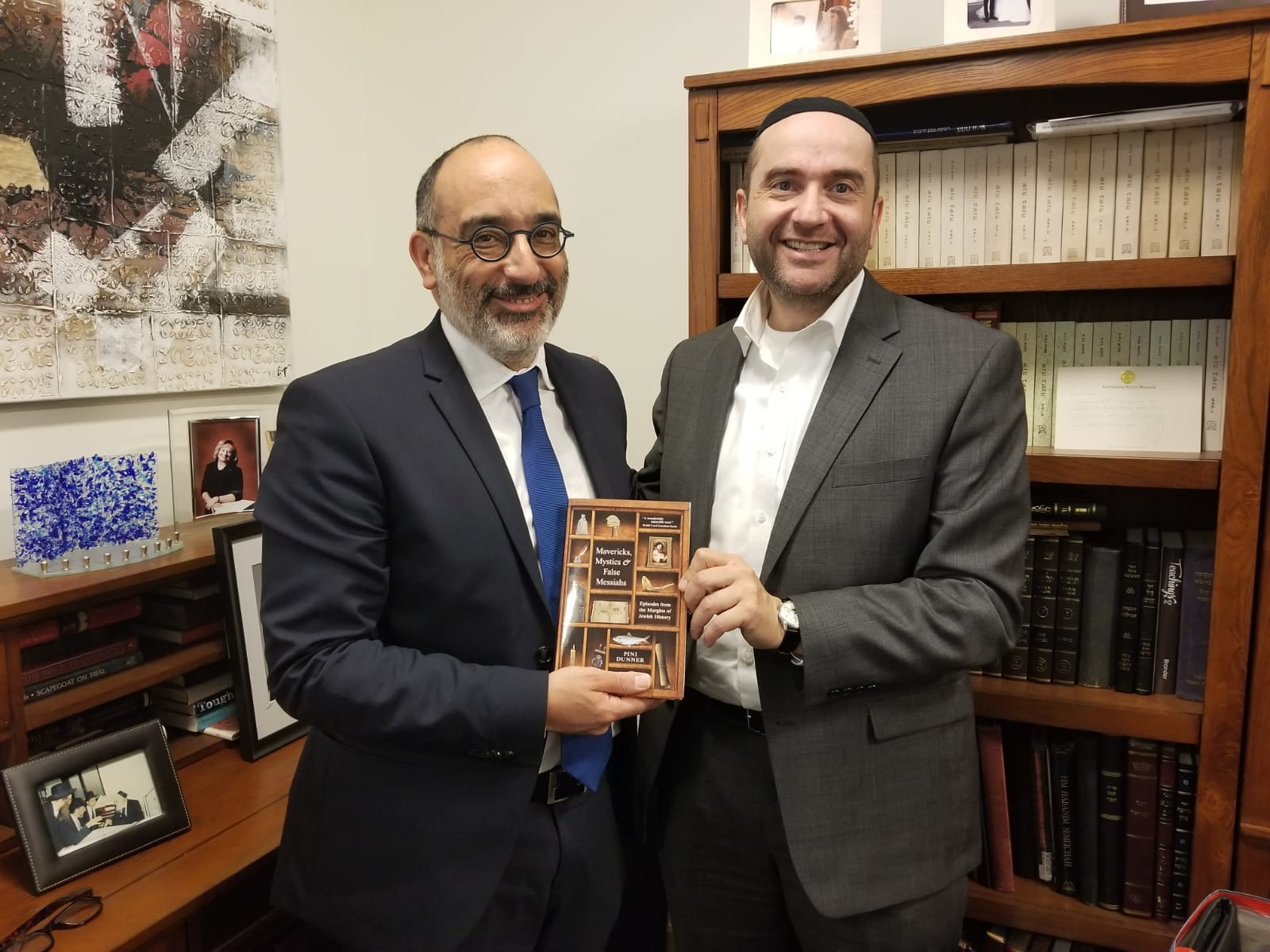 Rabbi Warren Goldstein, Chief Rabbi of South Africa, receives his copy of Rabbi Dunner's book Mavericks, Mystics & False Messiahs at Beverly Hills Synagogue, December 4, 2018