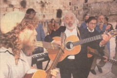 Rabbi Dunner accompanies the late Rabbi Shlomo Carlebach on his guitar for an impromptu concert at the Kotel (1990)